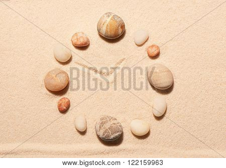 Watch From Sea Stones On Sand. Summer Beach Background