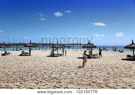 MAURITIUS - APRIL 24:tourists have a rest on the sandy beach of the island of Gabrielle on April 24 2012 in Mauritius.