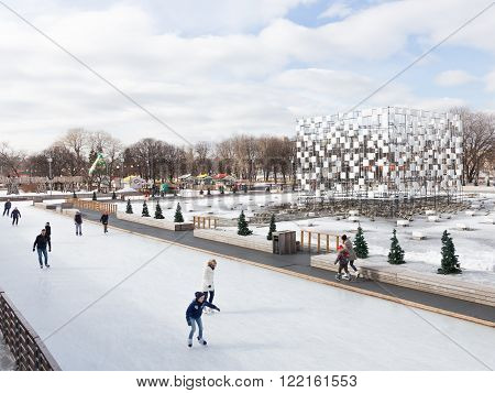 Moscow - March 13 2016: Lots of happy people ice-skating on the big beautiful outdoor skating rink in the Park of Culture and Rest Gorky March 13 2016 Moscow Russia