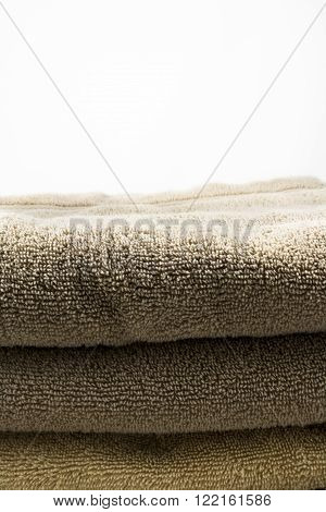 A stack of terry cloth towels with room for text