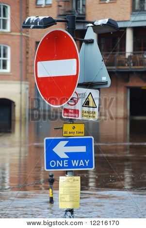 Flooded traffic sign on bank of River Ouse in York