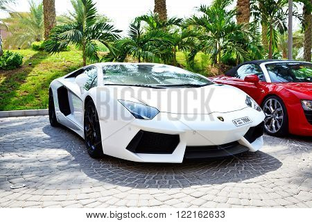 DUBAI UAE - SEPTEMBER 11: The Atlantis the Palm hotel and luxury sport cars. It is located on man-made island Palm Jumeirah on September 11 2013 in Dubai United Arab Emirates