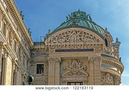 Architectural details of Opera National de Paris: Front Facade. Grand Opera (Garnier Palace) is famous neo-baroque building in Paris - UNESCO World Heritage Site. Vintage processing.