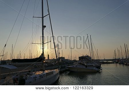 TRIESTE, ITALY - AUGUST 6, 2015 : Sunset in the nautical smaller boats port. Trieste, Italy.