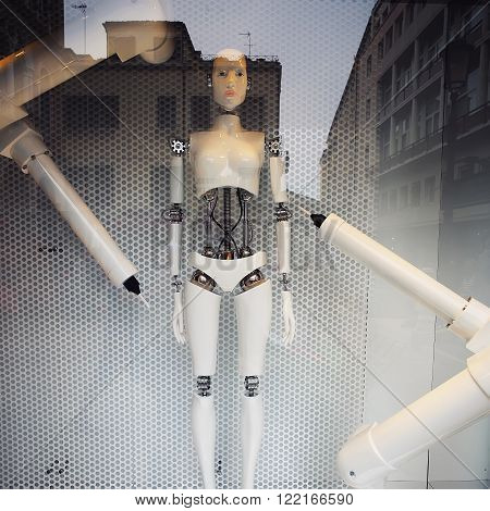 Robot Stands In Glass Window