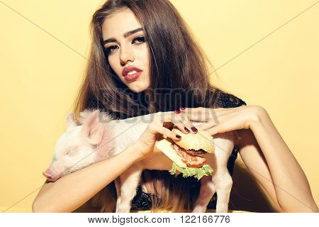 Woman With Burger And Pigglet