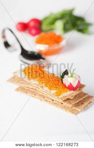 healthy food crispbread with red salmon caviar still life