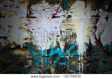Dramatic dark old stone wall with white and blue paint splashes - background for your grunge design