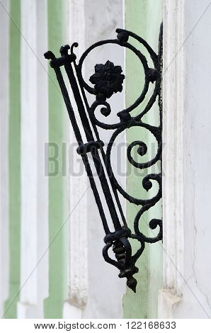 Old stylized flagstaff with floral ornament on building wall ,Odessa, Ukraine