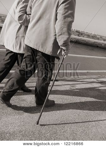 Sepia toned image of elderly couple strolling