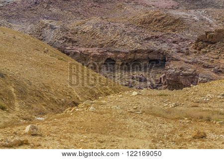 Ancient cave settlement Bedouins. Desert mountain landscape, Jordan. Sand and gravel hills and ravines in the mountain areas of Jordan. Desert mountain landscape