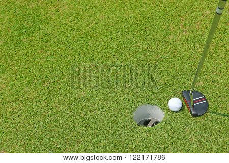 A flat head putter club to make short and low speed stroke for a golf ball to roll inside a cup hole