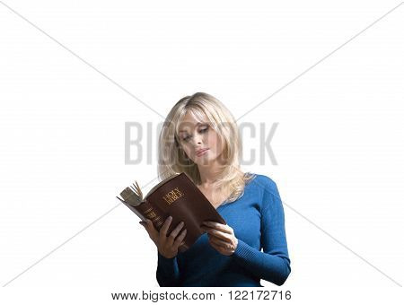 Woman reads a Christian Bible against white background.