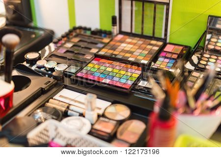 Close-up of a various makeup items arranged for use by professional make-up artist . Selective focus.