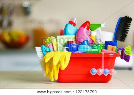 Cleaning set with products and tools in red tub