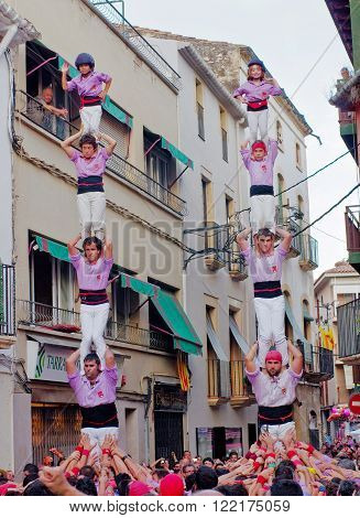TORREDEMBARRA SPAIN - JULY 13 2014: Castells Performance in Torredembarra Catalonia Spain. A Castell is a Human Tower built traditionally in Catalonia.