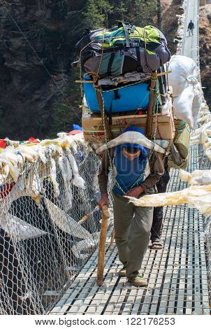 Porters Carry Heavy Load In Himalaya