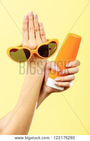 Woman Holds Sunglasses Sunscreen Lotion