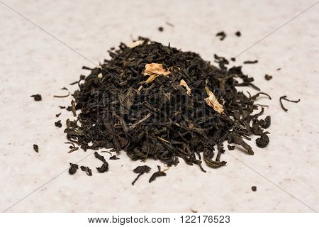 Dry green tea with jasmine on the kitchen table