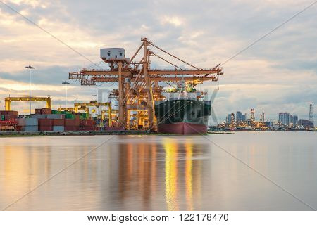 Industrial Container Cargo freight ship with working crane in shipyard