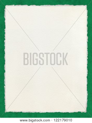 Watercolor paper with true deckled edges on a green background. File includes a clipping path.