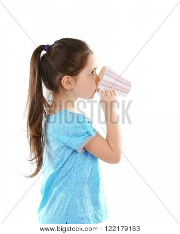 Little girl drinking water from cup, isolated on white