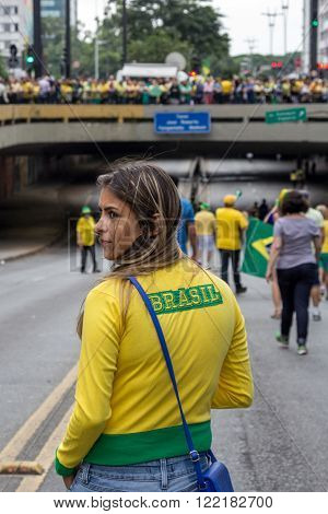 Sao Paulo Brazil March 13 2016: One unidentified girl in the biggest protest against federal government corruption in Sao Paulo.