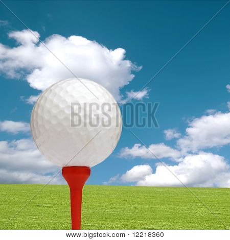 Golf ball and tee with green grass and cloudy sky