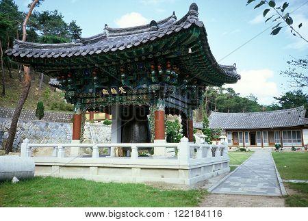 GYEONGJU, NORTH GYEONGSANG PROVINCE / KOREA - CIRCA 1987: A large bell hangs inside a pavilion at the Bori-sa Temple in Gyeongju.