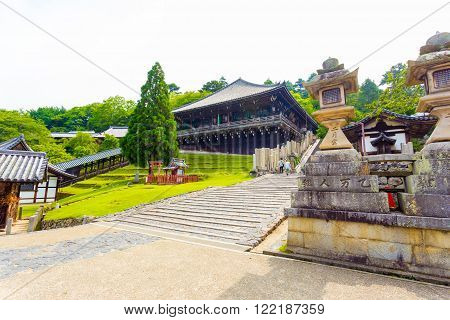 NARA, JAPAN - JUNE 24, 2015: Bottom of steps entering Nigatsu-do Hall on the Todai-ji temple complex on an overcast day in Nara Japan