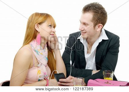 young couple listening to music with smarphone