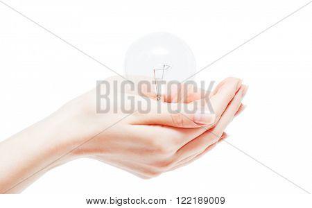 Lit lightbulb held in hand