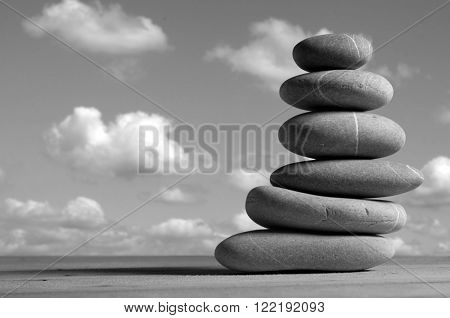 black and white photo of stones pile
