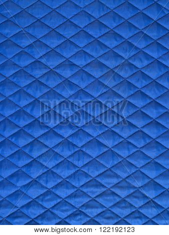 blue padded fabric, texture with rhomboidal shape