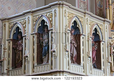STITAR, CROATIA - AUGUST 27: The evangelists on the pulpit in the church of Saint Matthew in Stitar, Croatia on August 27, 2015