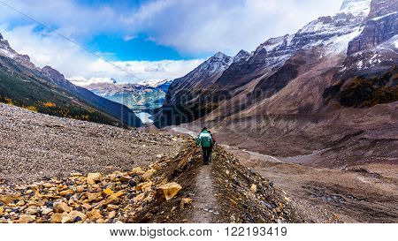 Hiking on the lateral moraine of the Victoria Glacier on the Trail to the Plain of Six Glaciers in Banff National Park in the Canadian Rocky Mountains