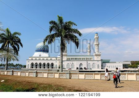 Kota kinabalu, Sabah Borneo - Feb 17, 2016: Tourist taking photograph of the Kota kinabalu City mosque, This mosque is one of the famous tourist attraction for its architecture and the building landscape is surrounded by a pool