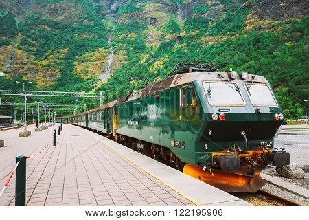 Flam, Norway - August 2, 2014: Flamsbahn In Flam, Norway. Green Norwegian Train On Railway. Famous Railroad