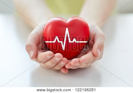 poster of health, medicine, people and cardiology concept - close up of hand with cardiogram on small red hear