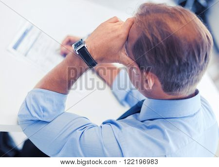 business, office, school and education concept - man signing a contract