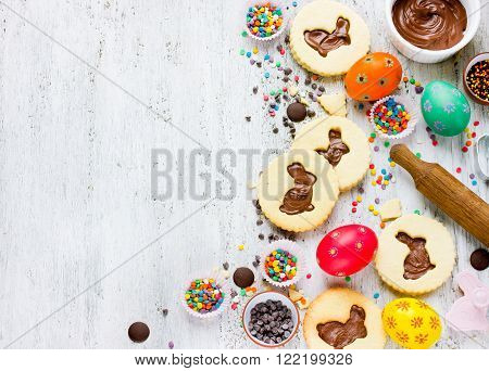 Cookies easter bunny colorful sprinkling chocolate decorative eggs top view. Food art idea for kids. Easter holiday baking background