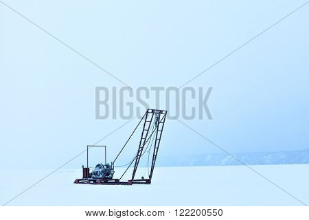 The study of the sun, the solar activity and earthquakes, seismic activity. Winch for the study of ice outdoors during the winter on the lake Baikal. Russia Siberia. Science and research station.