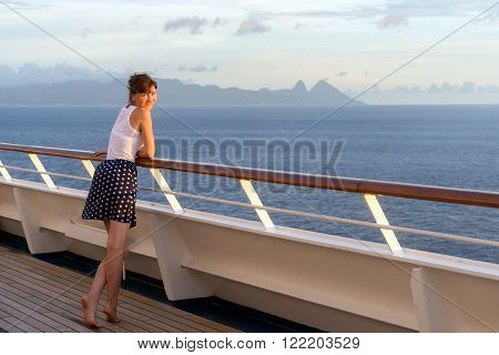 young woman in dress on a background of ocean