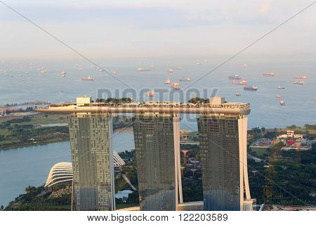 Singapore, Singapore - May 18, 2015: Marina Bay Sands hotel in Singapore. The hotel is a luxury resort famous for its infinity swimming pool. The hotel is a landmark in Singapore.