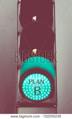 Close Up On Green Traffic Light Message Plan B