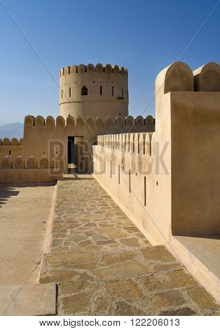 Historic adobe fortification watchtower of Sunaysilah Castle or Fort in Sur Al Sharqiya Region. Sultanate of Oman Middle East