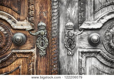 From old wooden hand-carved door with forged crank to the sketch. Art technique.