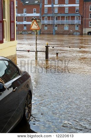 River Ouse flood waters reach parked car in York street. North Yorkshire, UK.
