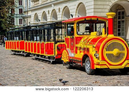 Lviv, Ukraine - August 3, 2015: Lviv city center. Market square. Sightseeing tour train.