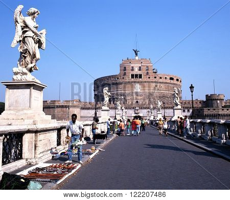 ROME, ITALY - SEPTEMBER 11, 1992 - Street sellers on the Ponte Sant Angelo with Castle San Angelo to the rear Rome Italy Europe, September 11, 1992.